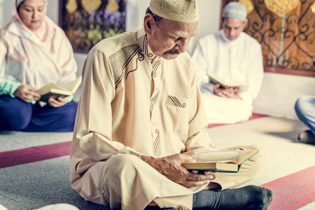 Muslims reading from the quran Stock Photo - 104032307