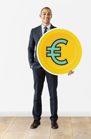 Businessman with Euro currency icon Stock fotó