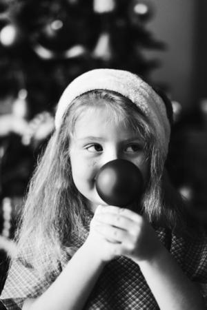 Young Caucasian girl enjoying the Christmas holiday Stock Photo