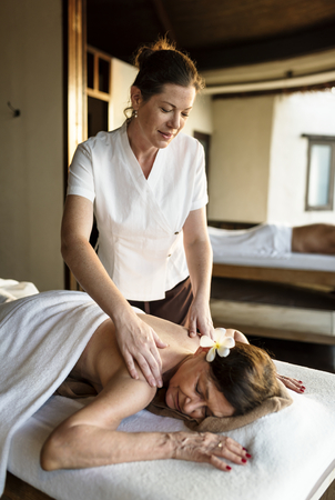 Female message therapist giving a massage at a spa Stock fotó