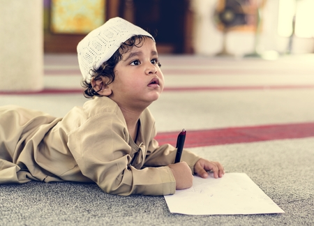Muslim boy learning in a mosque