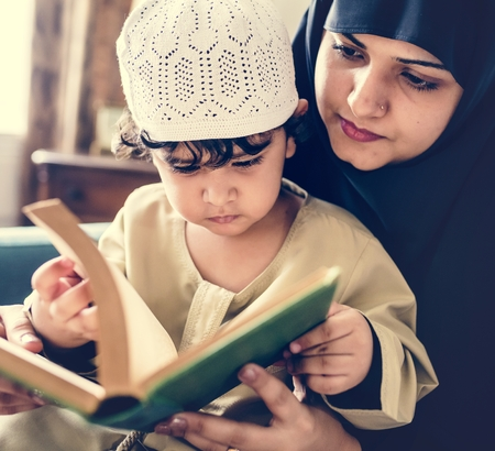 Muslims reading from the quran Stock Photo - 104032831