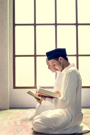 Muslims reading from the quran Stock Photo - 104032911