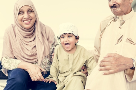 Muslim grandparents with their grandchild