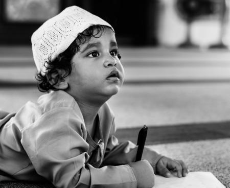 Muslim boy learning in a mosque
