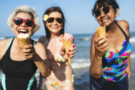 Senior friends having fun at the beach