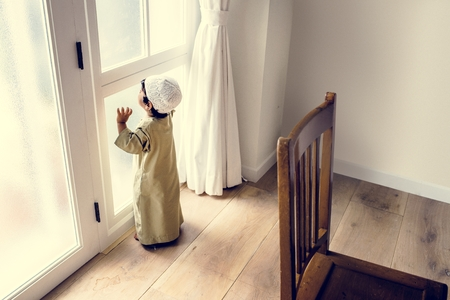 Muslim boy playing at home Stock Photo