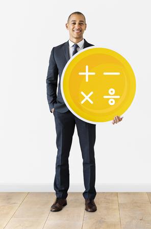 Business man holding calculation symbols icon