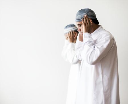 Muslim prayers in Takbiratul-Ihram posture Stock Photo - 104033255
