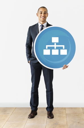 Businessman holding a business chart icon Stock fotó