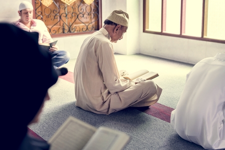 Muslims reading from the quran Stock Photo - 104033391