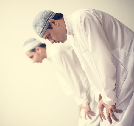 Muslim prayers in Ruku posture