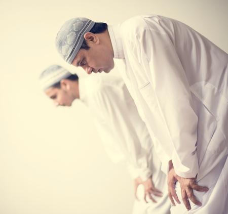 Muslim prayers in Ruku posture 스톡 콘텐츠 - 104033404