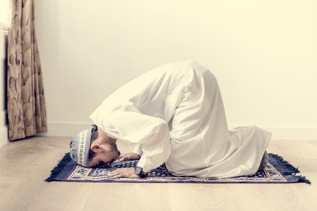 Muslim boy praying in Sujud posture Stock Photo