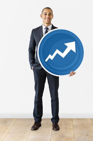 Businessman holding a development icon