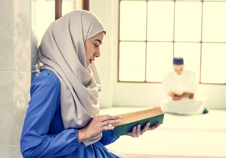 Muslims reading from the quran Stock Photo - 104034020