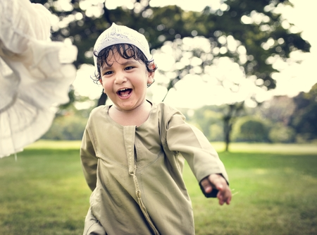 Muslim brother and sister playing in the park Stock Photo - 104034474