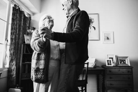 Senior couple dancing together at home Stock fotó
