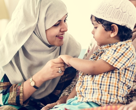 Happy Muslim mother and son
