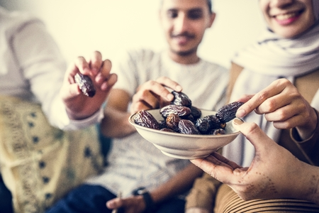 Muslim family having dried dates as a snack