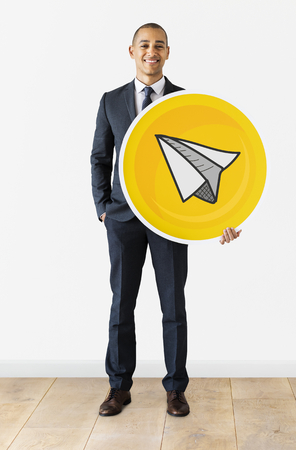Businessman with a paper plane icon