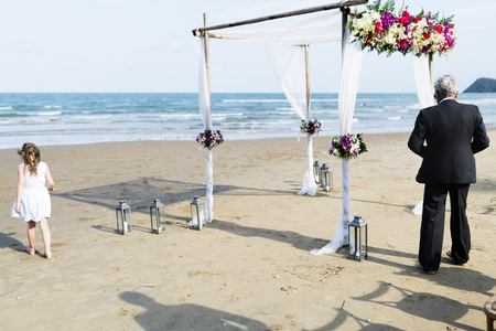 Guests at a beach wedding 스톡 콘텐츠