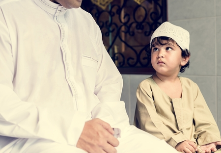 Muslim boy learning how to Salah Stock Photo - 104035111