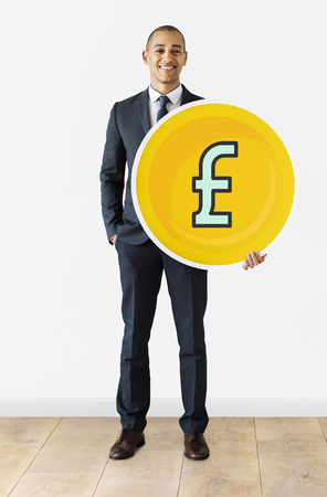 Businessman with Pound currency icon