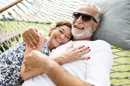 Couple relaxing on a hammock Stock Photo