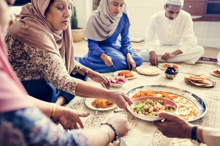 Muslim family having dinner on the floor Stock Photo - 104035296