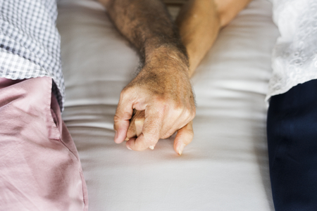 Senior couple holding hands at a resort 스톡 콘텐츠