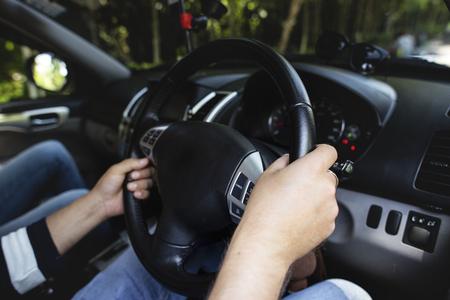 Man driving a family car