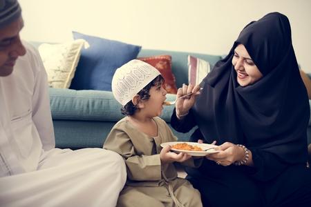 Muslim family having dinner on the floor Stock Photo - 104035434