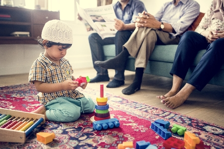 Muslim family relaxing and playing at home Stock Photo - 104035617