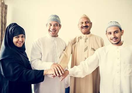 Muslim group of friends stacking hands Stock Photo