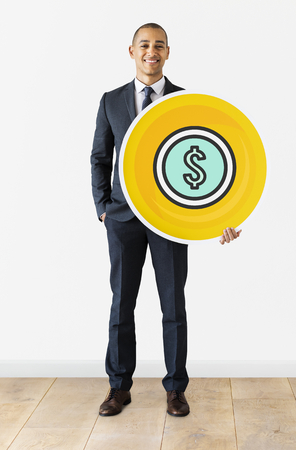 Businessman standing with dollar currency icon