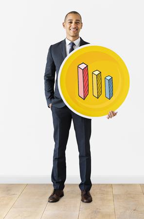 Businessman with bar chart icon Фото со стока