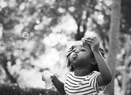African kid playing with bubbles