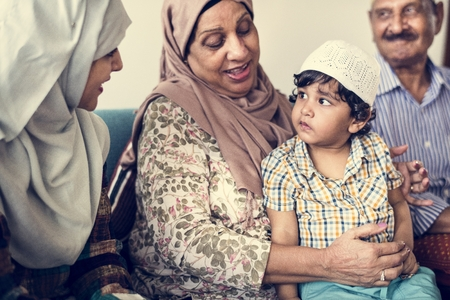 Muslim little boy with his family