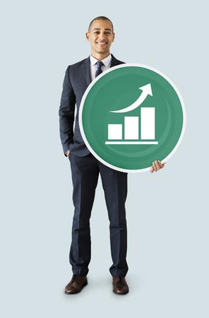 Businessman holding a graph icon Stock fotó