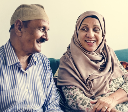 Mature Muslim couple at home Stock Photo - 104388220