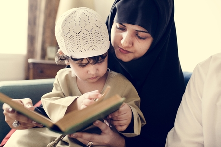 Muslims reading from the quran Stock Photo - 104388525