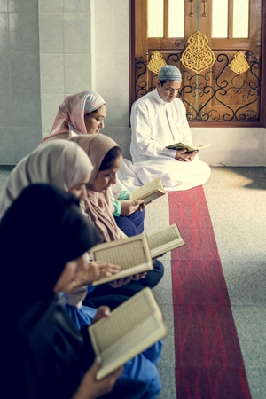 Muslims reading from the quran Stock Photo - 104310115