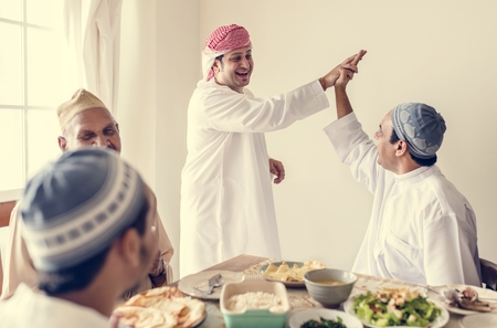Muslim men making a high five