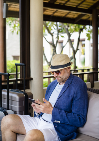Man using mobile phone at hotel lobby