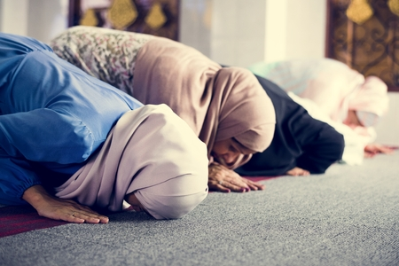 Muslim women praying in the mosque during Ramadan