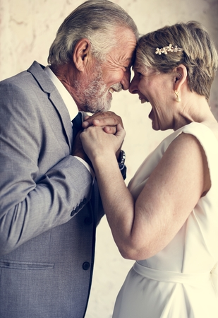 Senior Couple Holding Hands Together Cheerful Stock Photo - 104390666