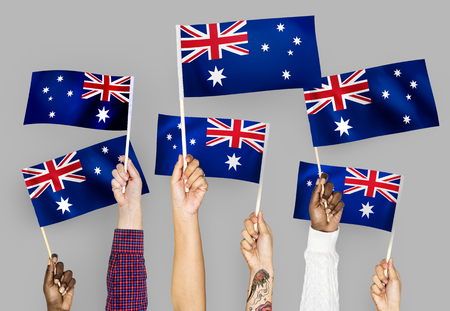 Hands raising Australia national flags