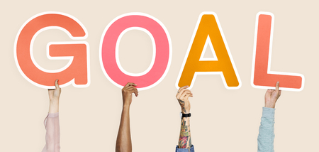 Diverse hands holding the word goal