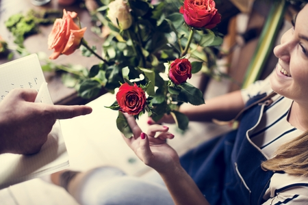 Florist with a bouquet of roses. 版權商用圖片